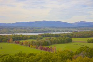 Vista of trees, lawns, Hudson River, Kingston-Rhinecliff Bridge and Catskills in during autumn
