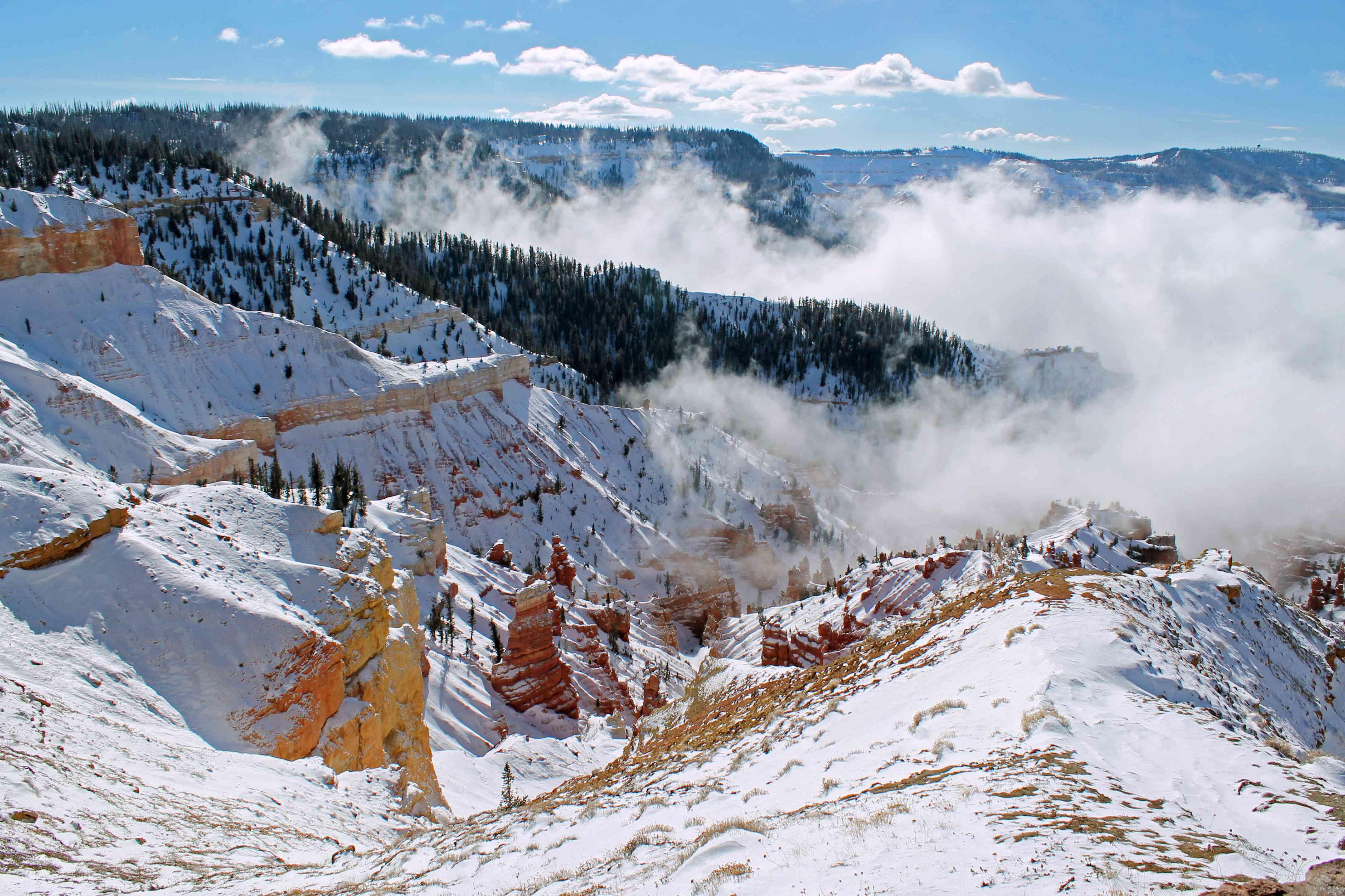 Clouds over snowy mountains, Brian Head, Utah, USA