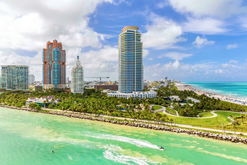 Panoramic view of beach at Miami south pointe park with high skyscrapers and a blue sunny summer sky, Florida.
