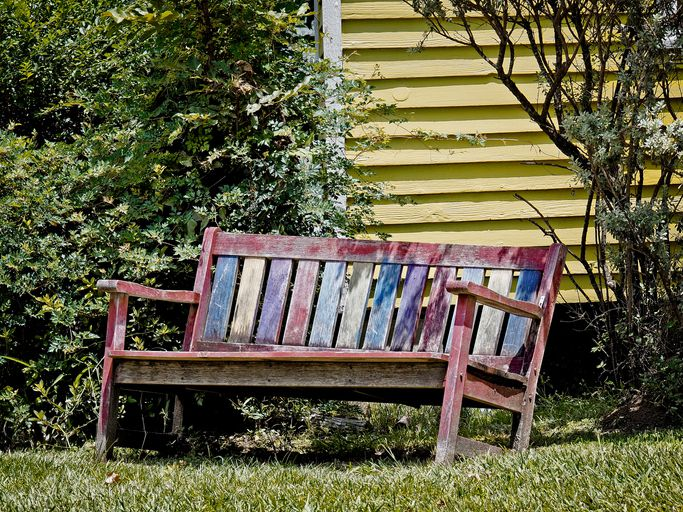 Old Red Yellow & Blue Wooden Bench in Spring, Texas
