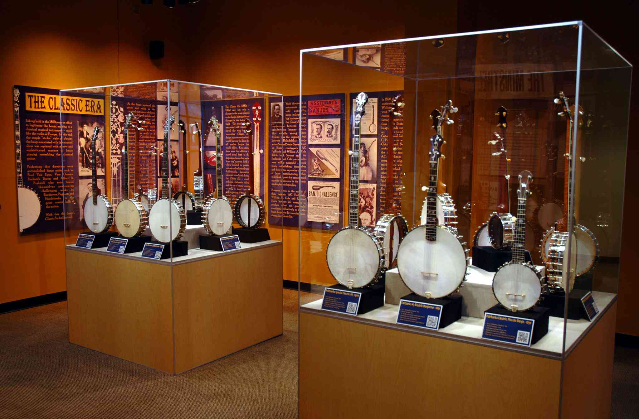 Two display cases of filled with various banjos