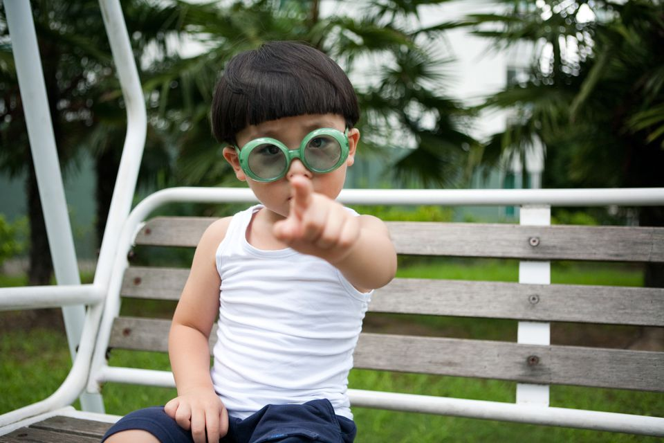Asian boy pointing at you