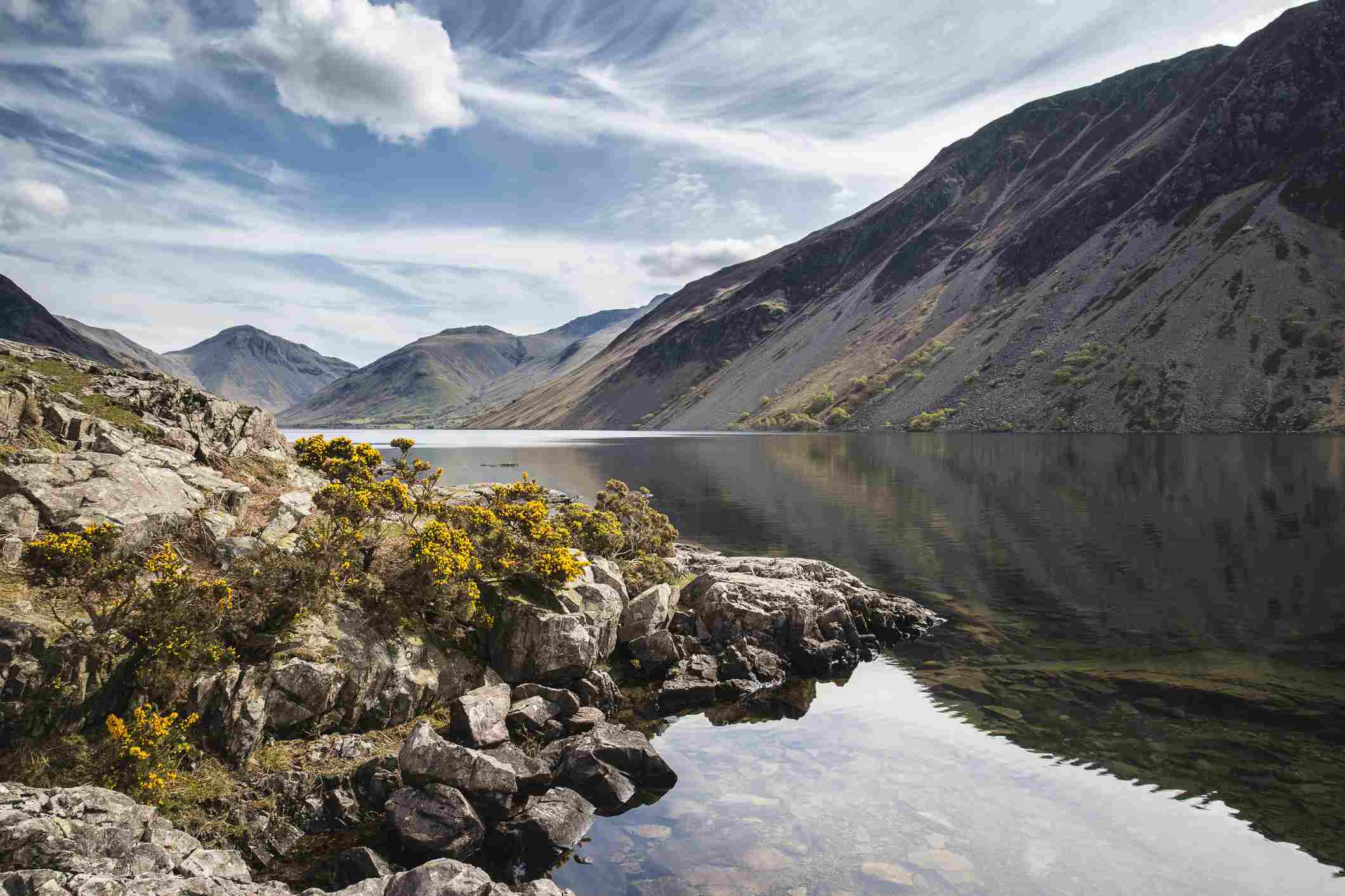 Lake District mountains landscape reflected in still lake of Wast Water
