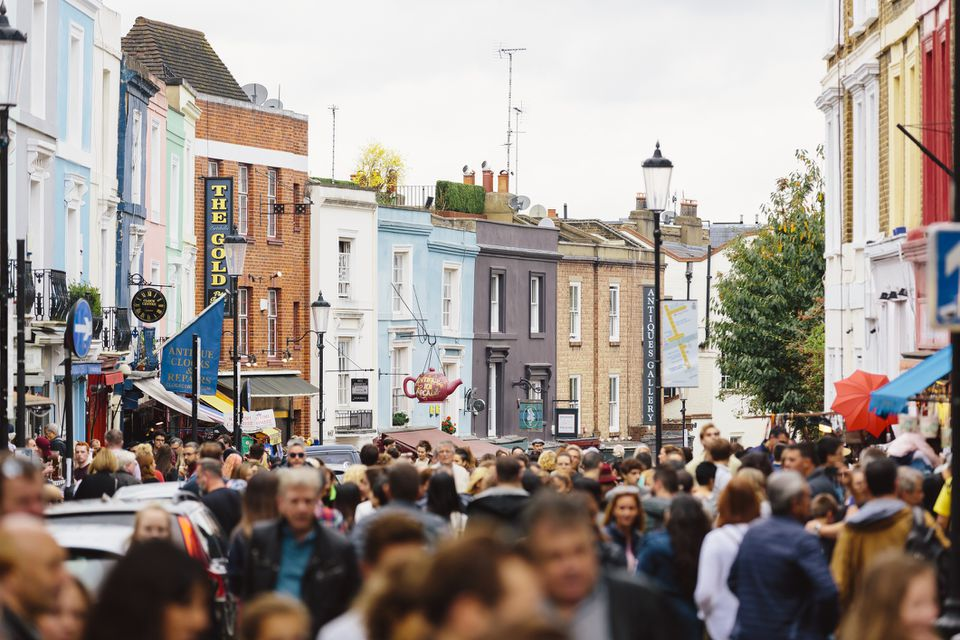 Crowded street at Portobello Road Market in Notting Hill, London, UK