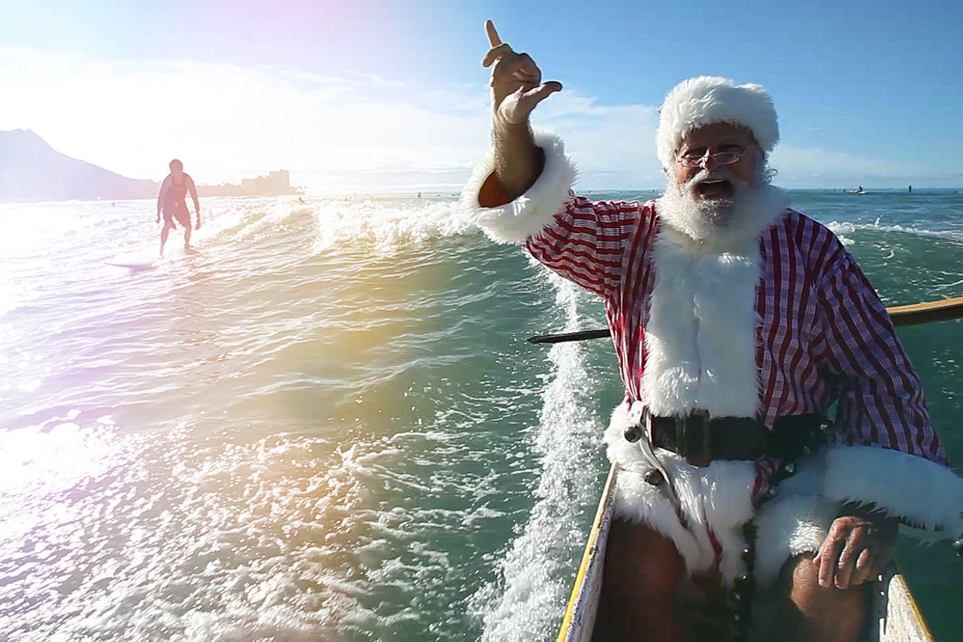 Santa catching waves