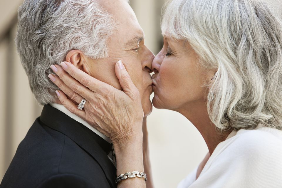 Married older couple kissing