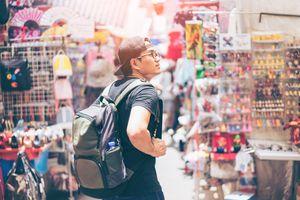 Young man traveler is visiting at Mongkok in Hong Kong