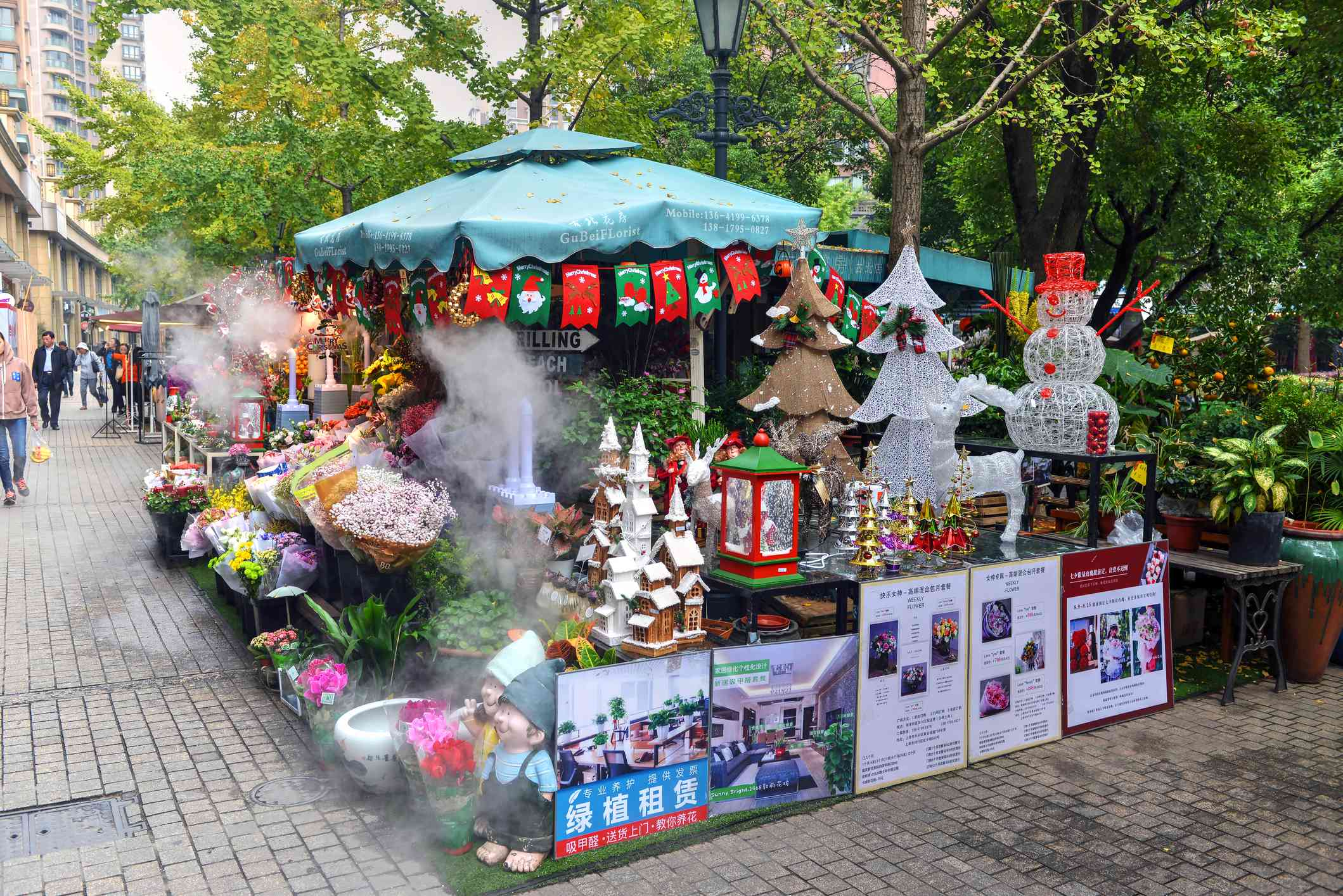 Shanghai, China - November 14, 2017: Christmas decorations on display at flower kiosk in the Gubei Golden Street area of Shanghai. Christmas decorations are becoming more popular in China