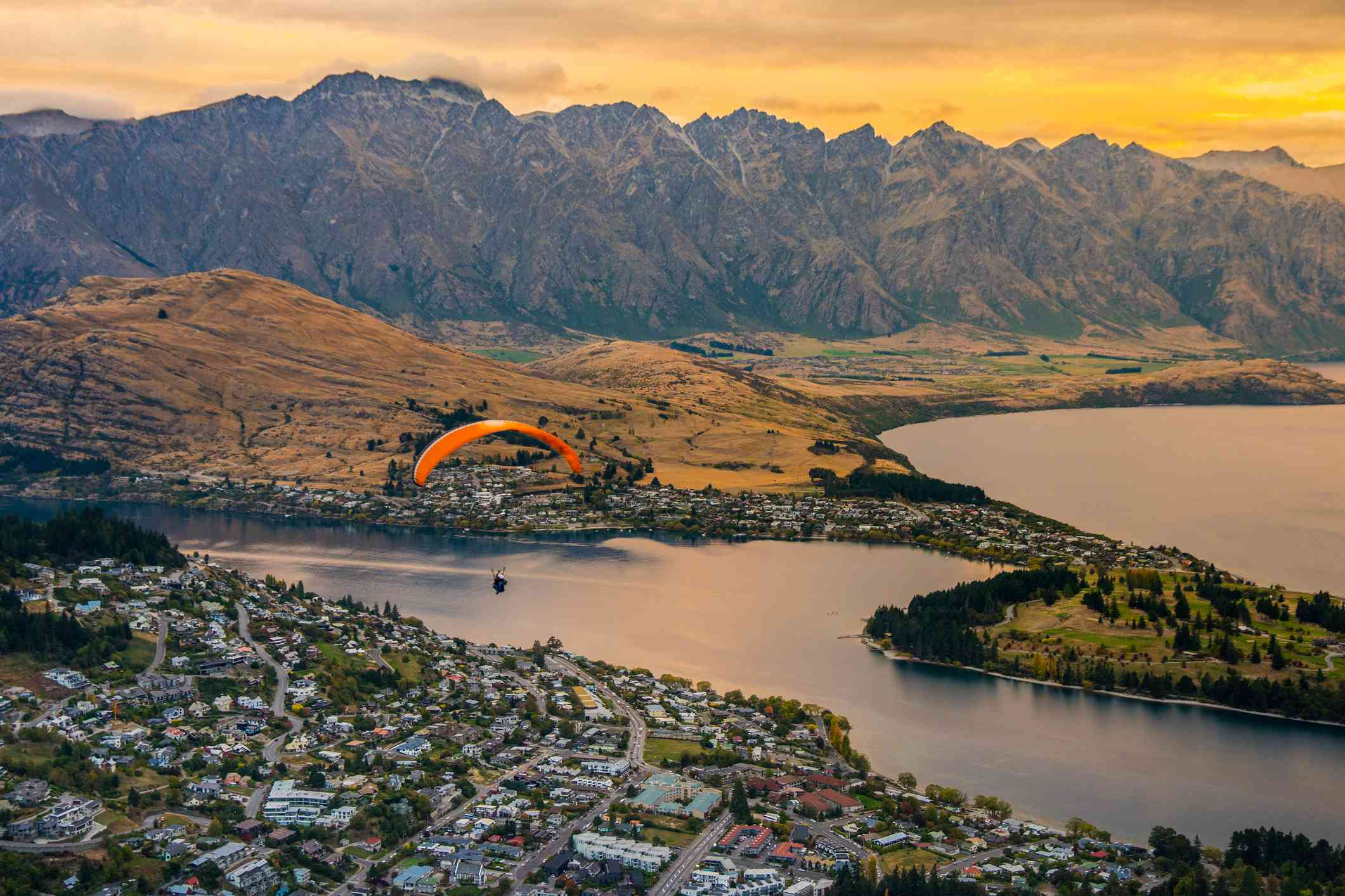 Paragliding over Queenstown and Lake Wakaitipu from viewpoint at Queenstown Skyline, New Zealand