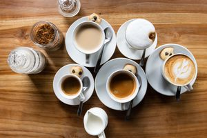 A picture showing a top down view of several coffee drinks, including espresso, cappuccino, and others