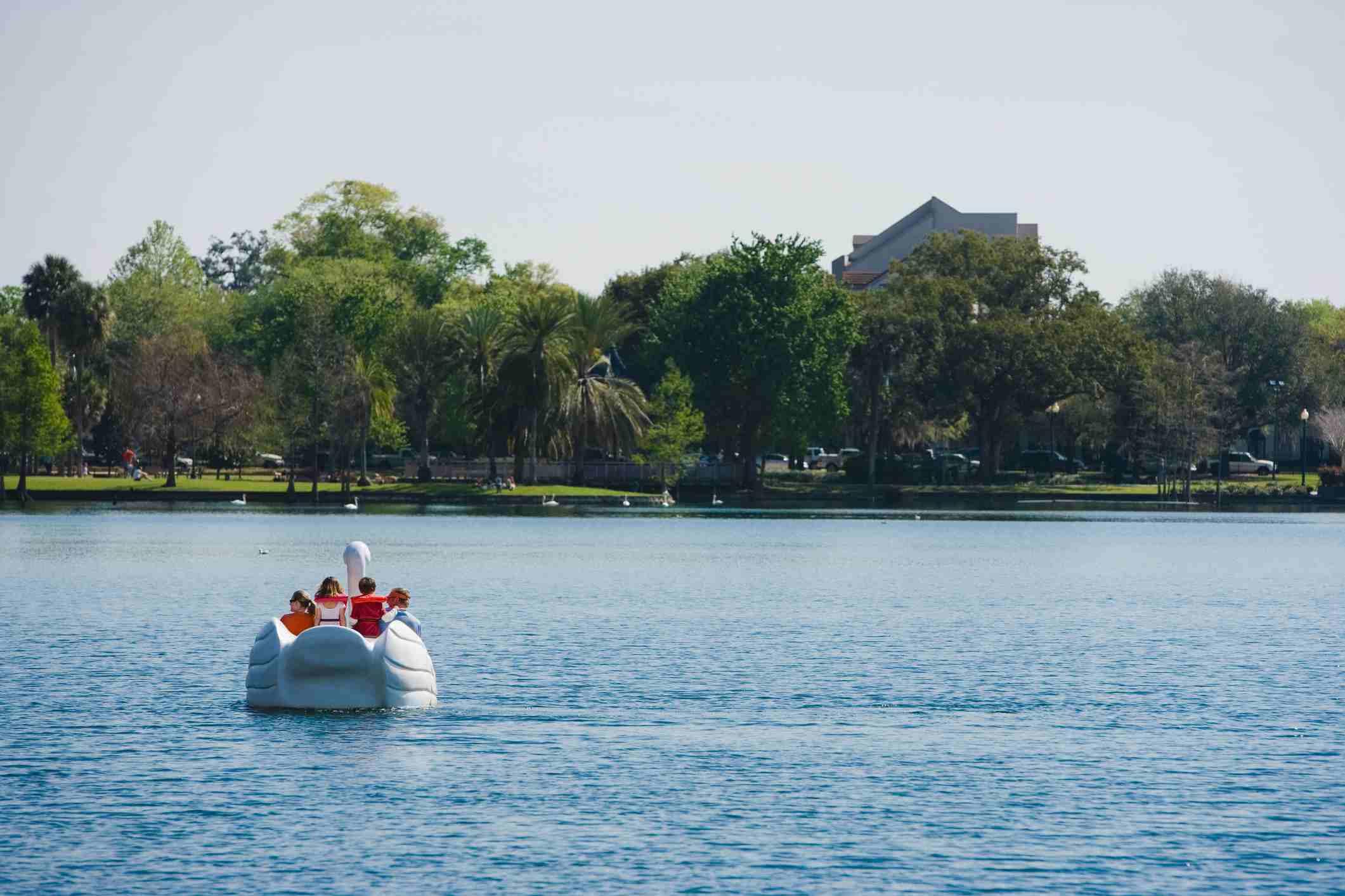 Four people on a pedal boat, Lake Eola Park, Orlando