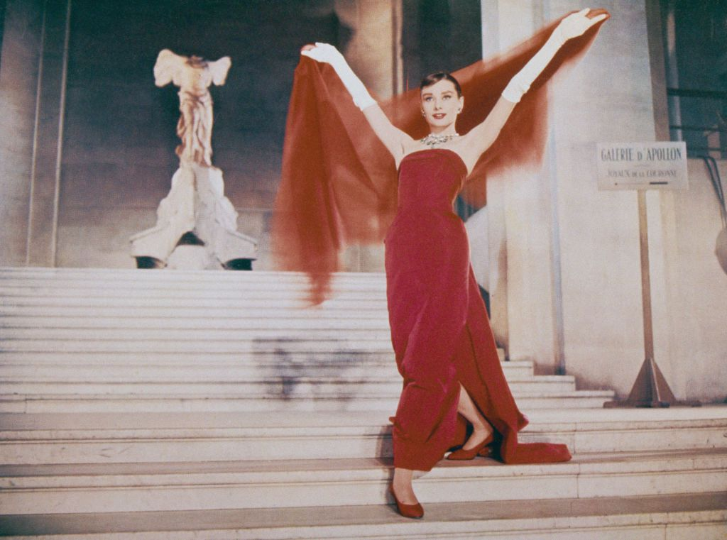 Audrey Hepburn descends the Daru Staircase at the Louvre in Paris, in a scene from the film 'Funny Face', 1957.