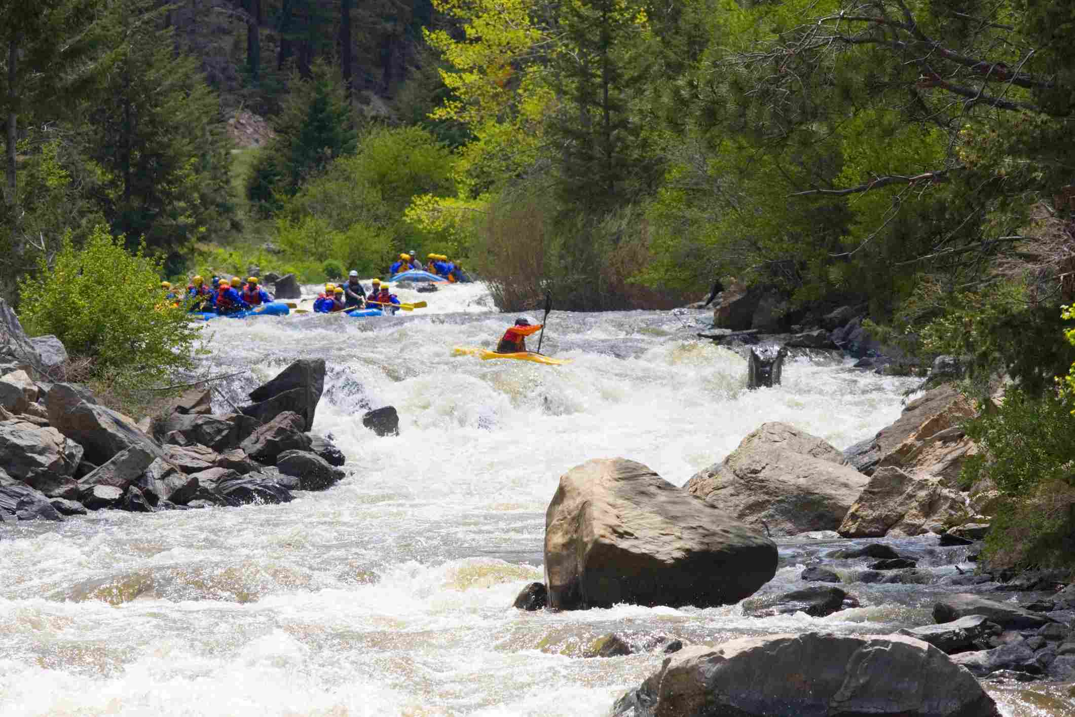 White water rafters and Clear Creek Rafting Company negotiate the whitewater of Clear Creek Colorado near Idaho Springs.