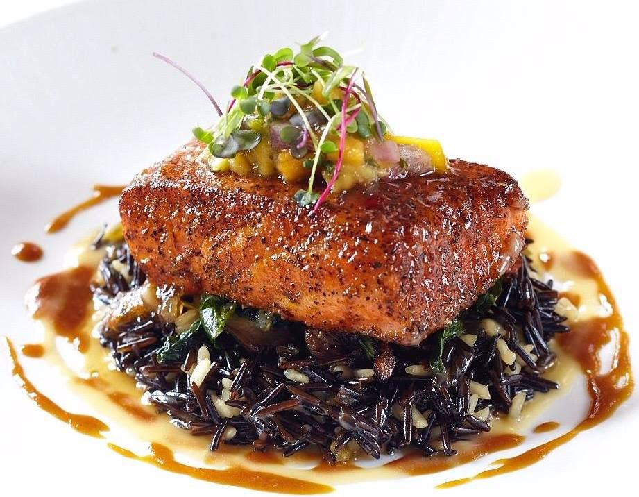 Grilled salmon on a bed of wild rice from Nick's Fishmarket Maui