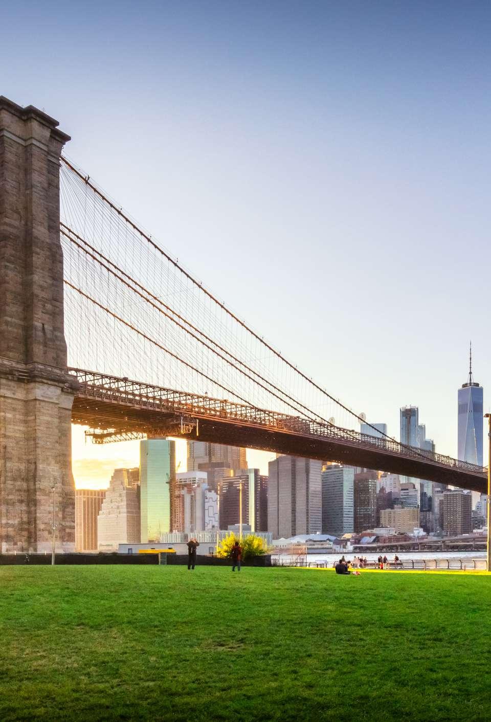 Brooklyn Bridge and Manhattan at sunset.