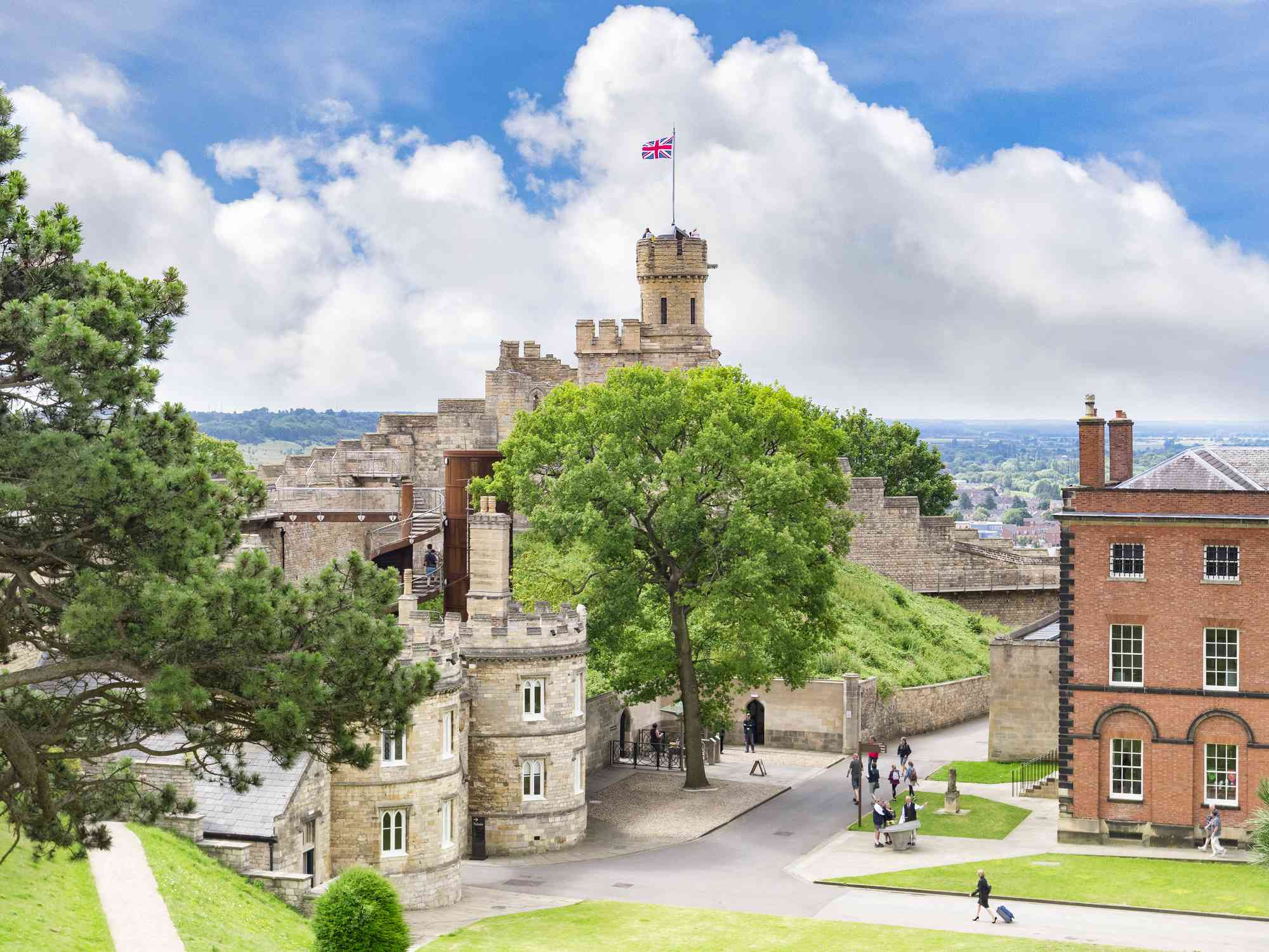 Lincoln Castle, UK, with Tourists Walking in the Grounds