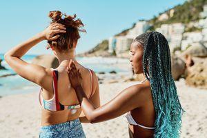 Woman applying sunscreen on friend