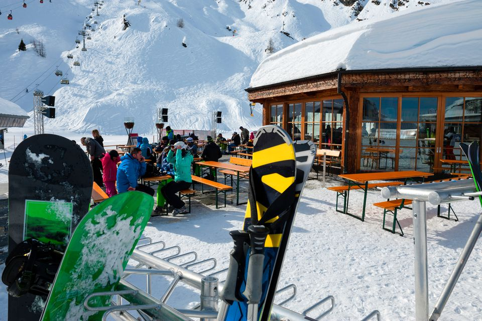 Skiers at a cafe after day on the slopes