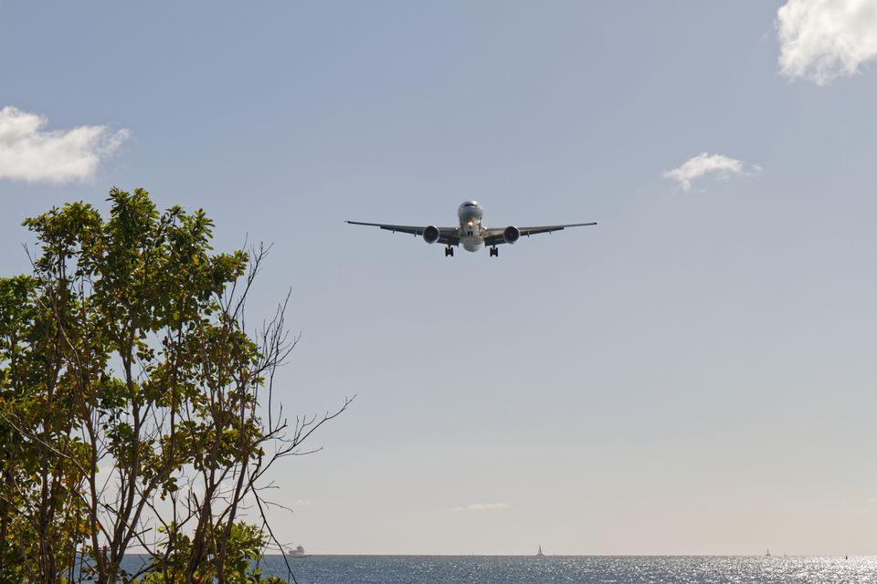 plane landing at Aimé Césaire Airport