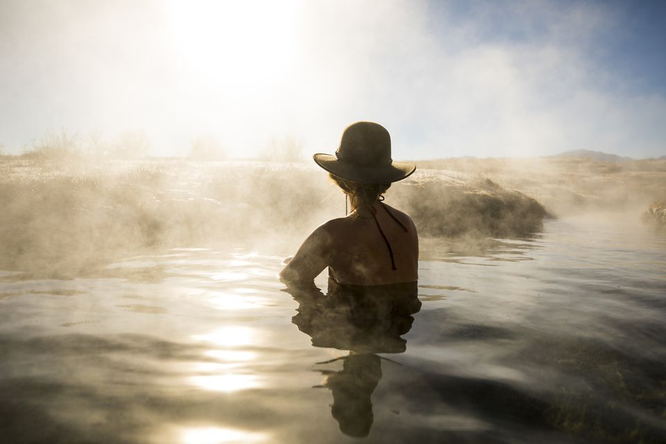 A woman relaxing in a hot spring