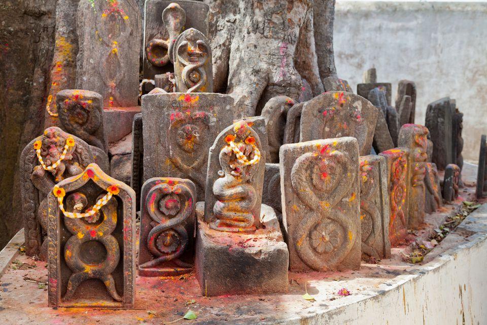 Naga snake god Hindu statues in temple.