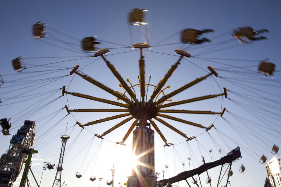 carnival guests riding a chair carnival swing ride at the Los Angeles County Fair