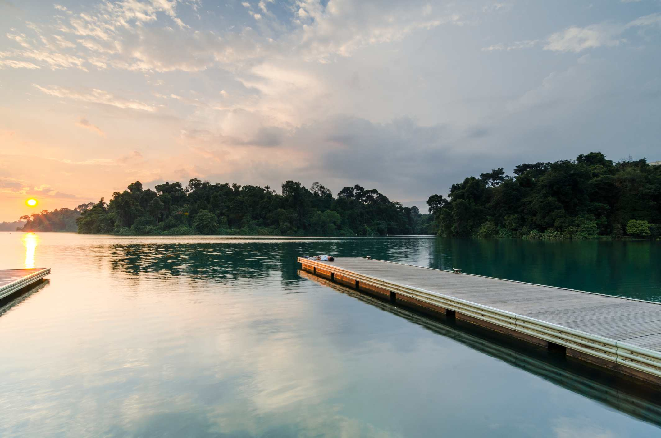 Beautiful sunset at MacRitchie Reservoir which is Singapore's oldest reservoir completed in 1868.