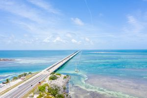 Aerial point of view of the Florida Keys oversea highway bridge crossing from island to island.