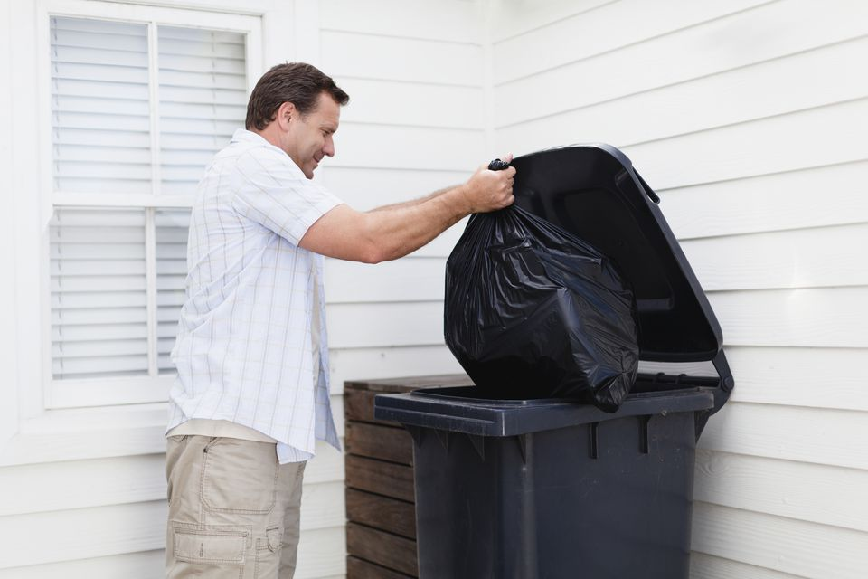 Man taking out garbage