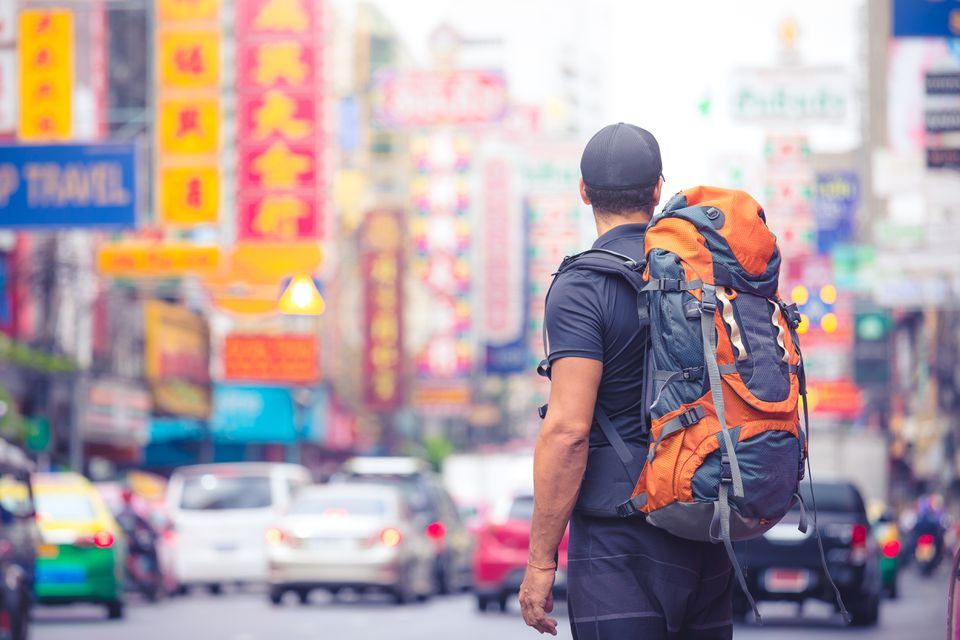 A backpacker stands in Chinatown, Bangkok