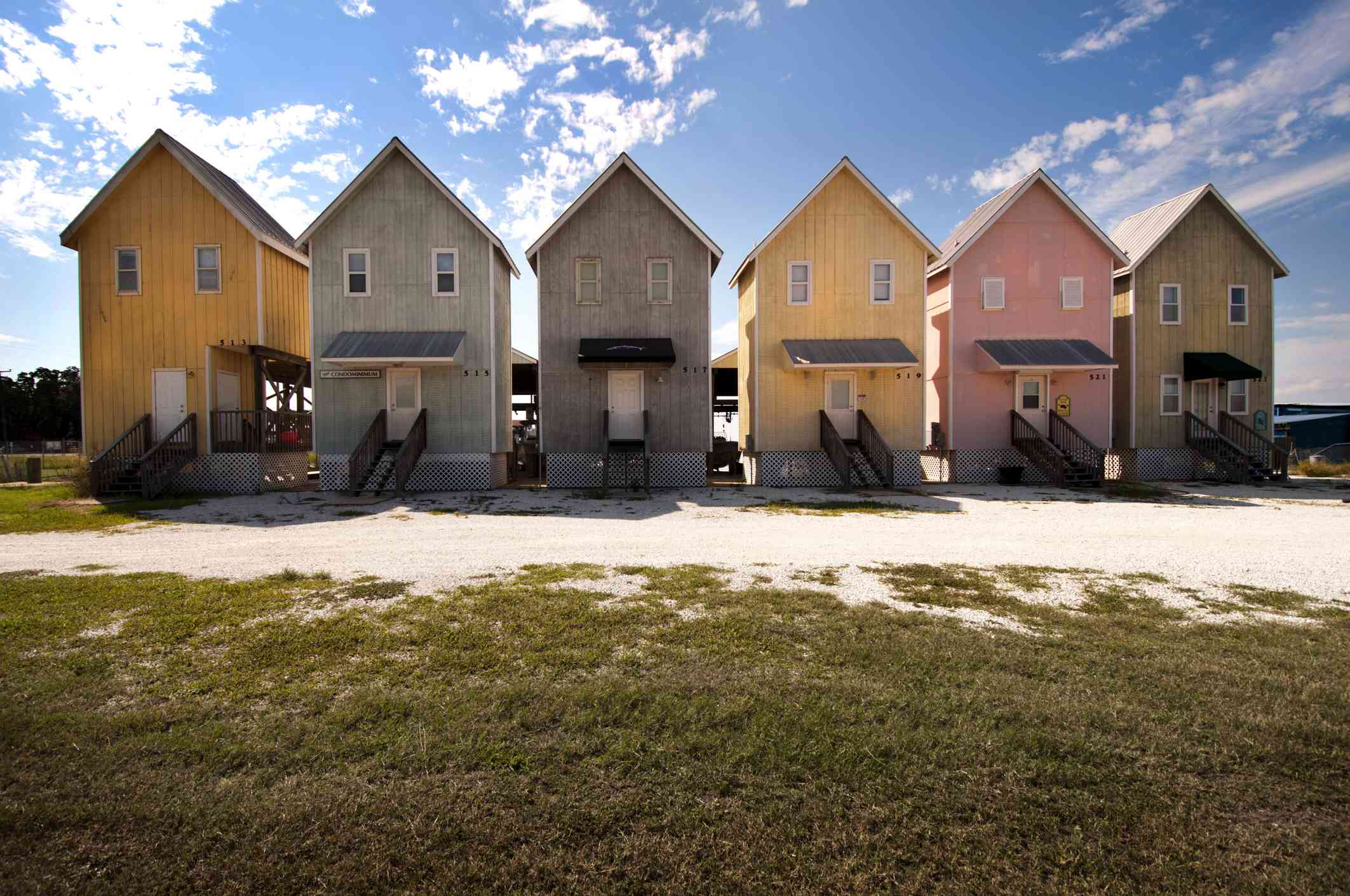 Vacation Condos, six in a row, brightly painted wooden, chalett style