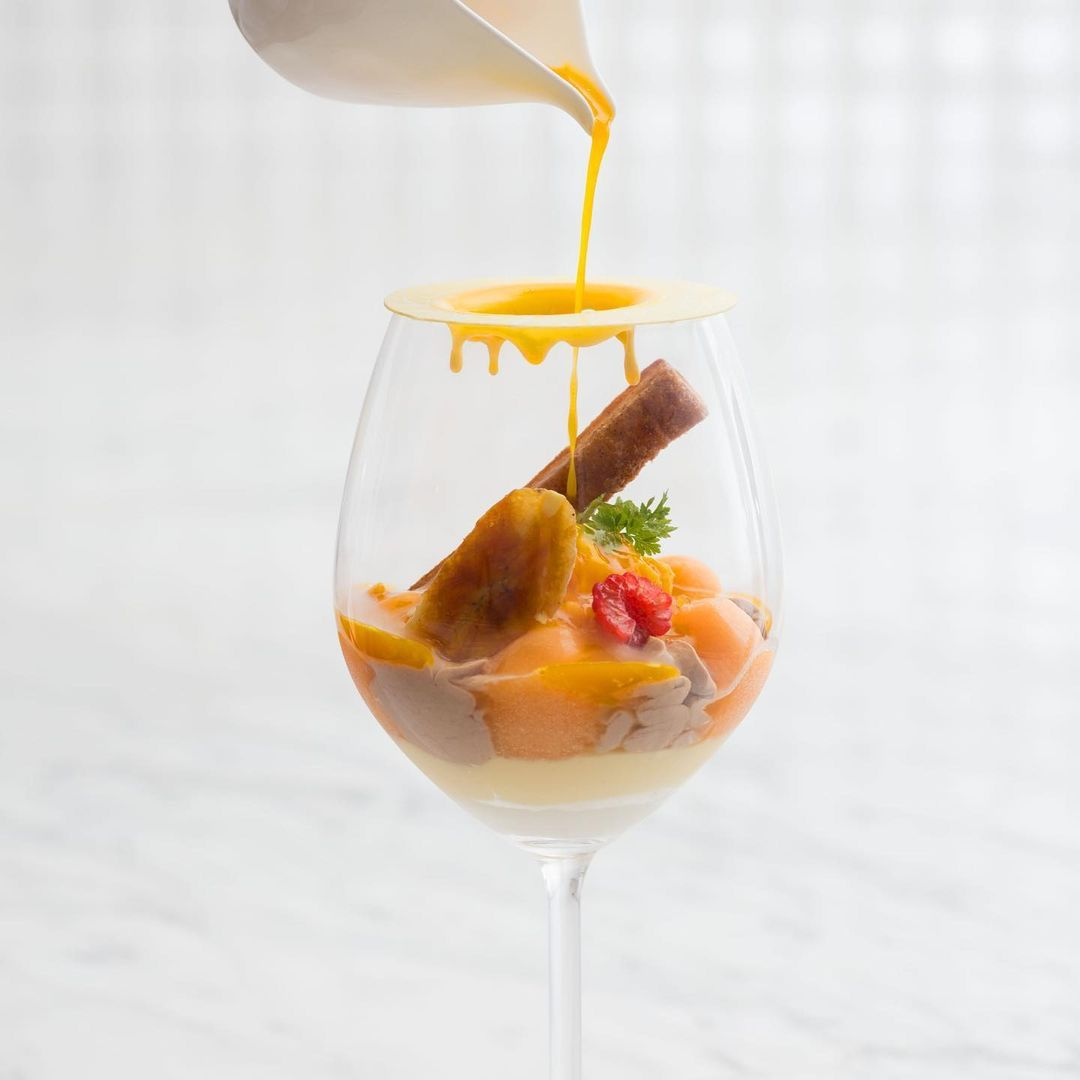 Wine glass filled with a fruit dessert