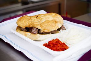 Cevapcici in flatbread with onions and ajvar