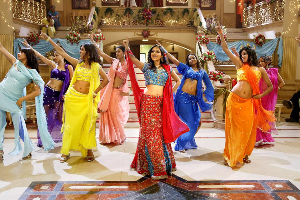 Female Bollywood dancers doing routine on set