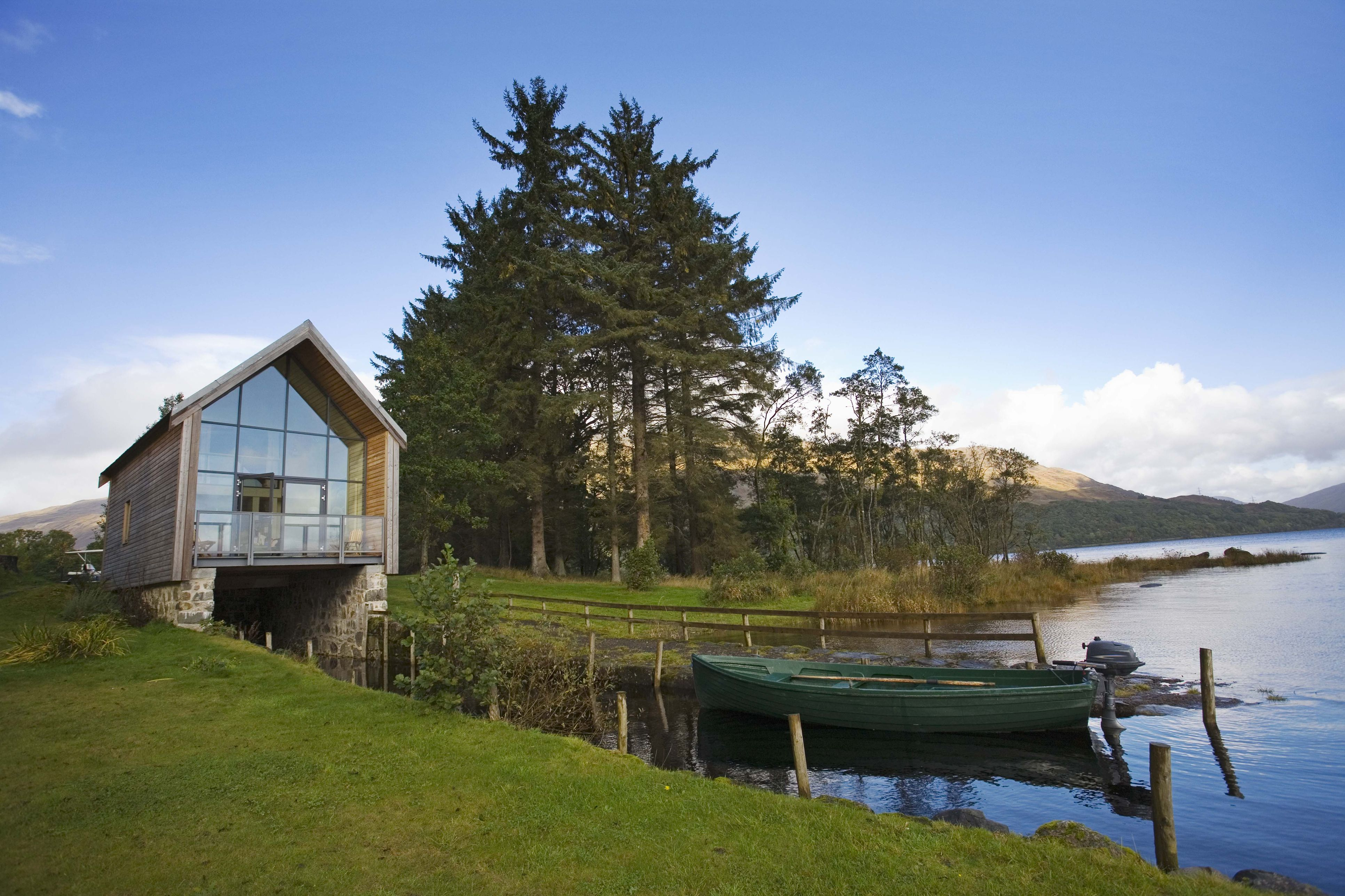 Boathouse and rowing boat on Loch Awe, Highlands of Scotland