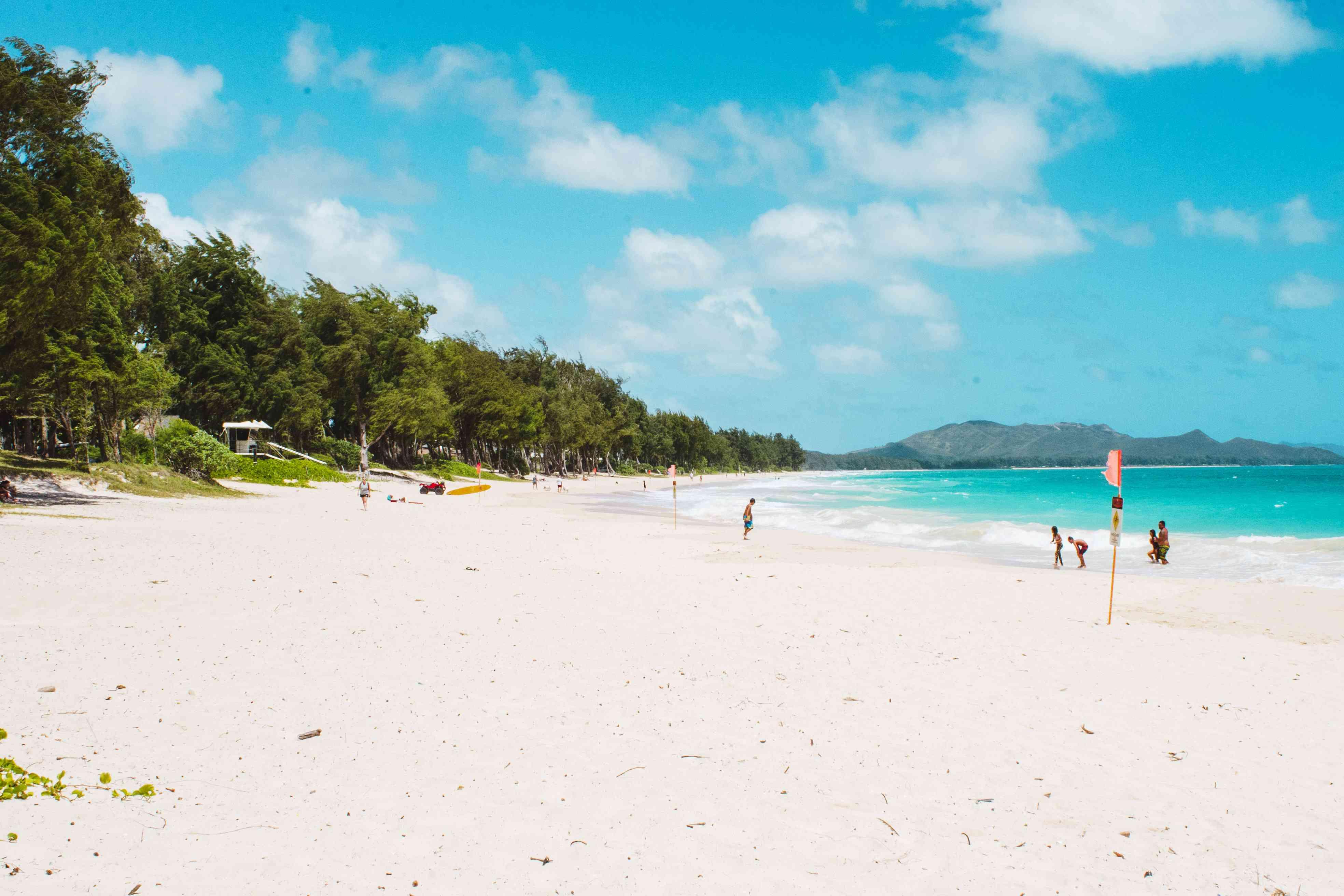 People playing on the beach at Waimanalo Beach