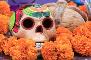Sugar skull and pan de muerto at Day of the Dead altar