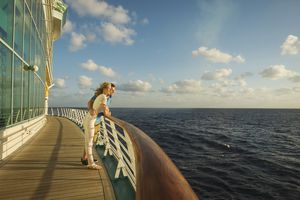 Caucasian couple admiring view from cruise ship deck