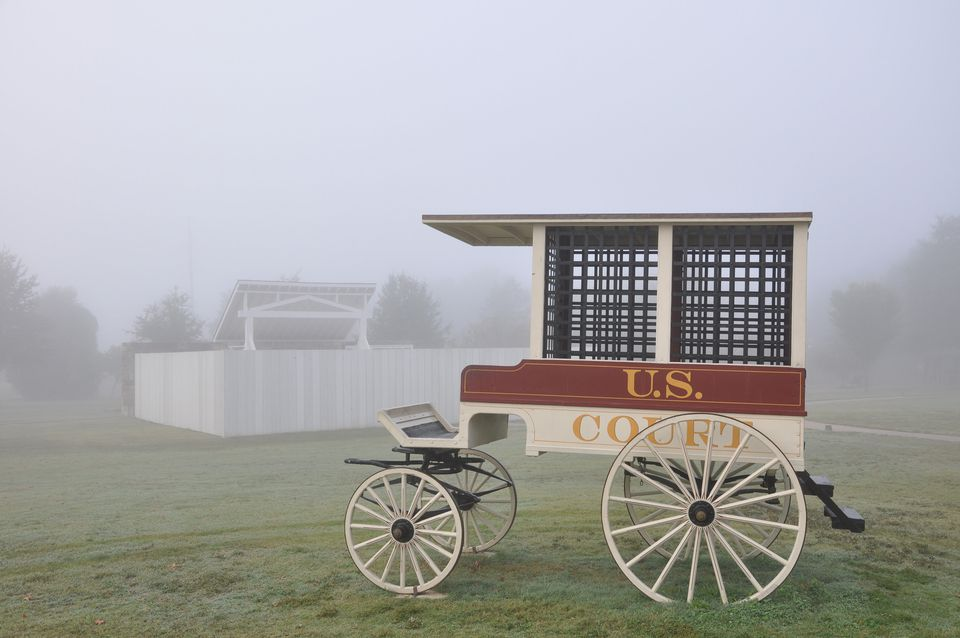 Recreated jail wagon and the gallows in fog at the Hell on the Border Jail in Fort Smith, Arkansas