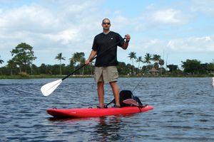 man paddling a SUP-kayak hybrid