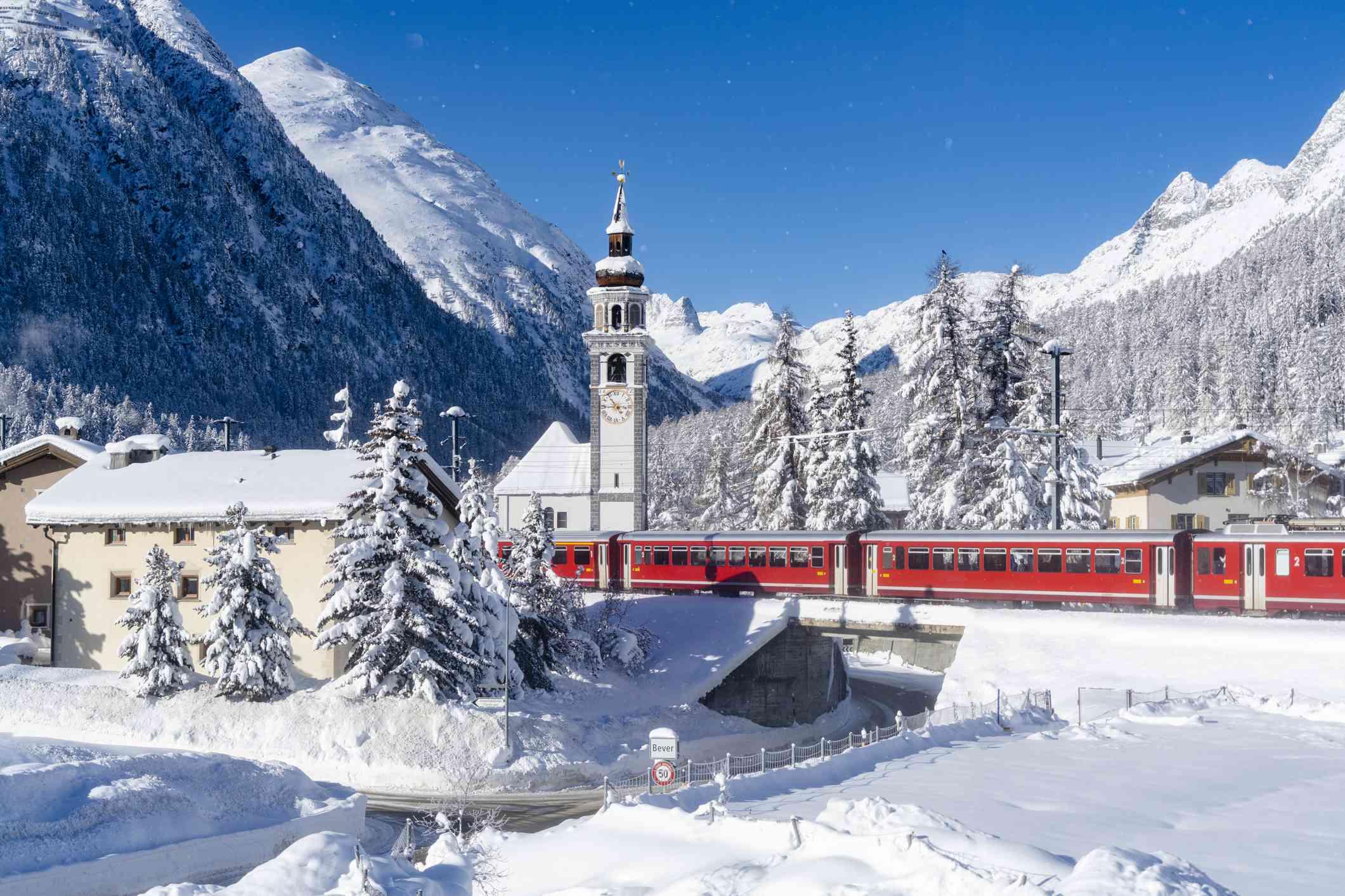 Bernina Express train along the snow capped village, Switzerland