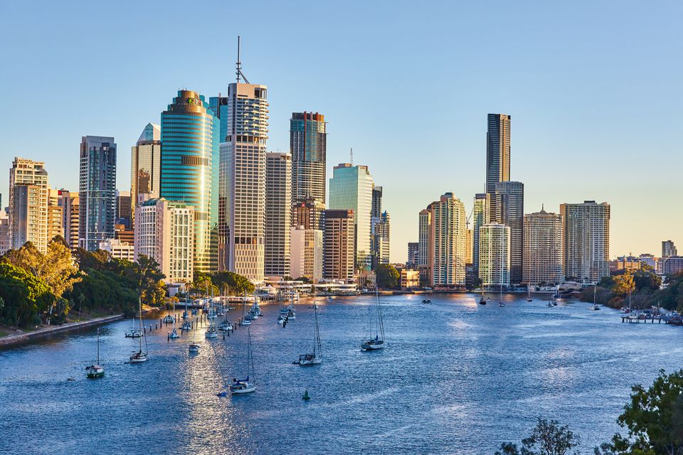 Buildings of the Central Business district of Brisbane City bathed in early morning sunrise light with the Brisbane River