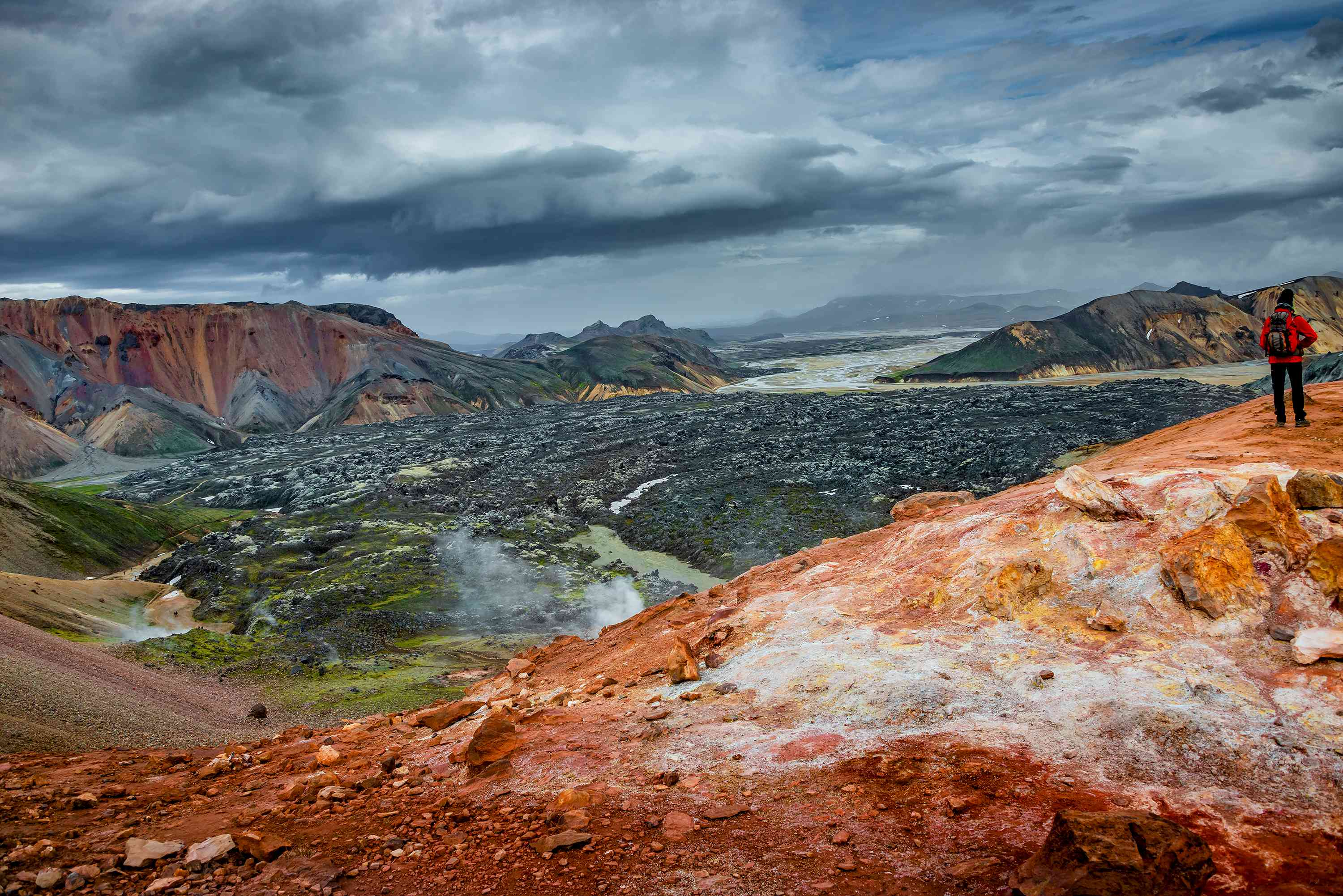 Beautiful colorful volcanic mountains Landmannalaugar and hikers on trail, Iceland