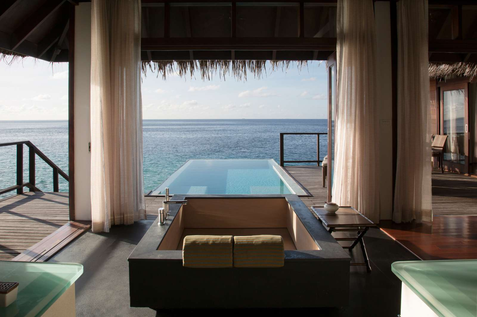 Maldives villa with a soaking tub and infinity pool overlooking the ocean