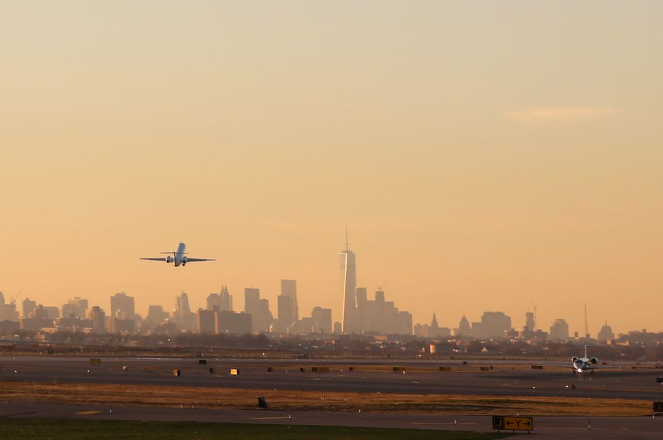 Airplane Take Off with New York City Skyline
