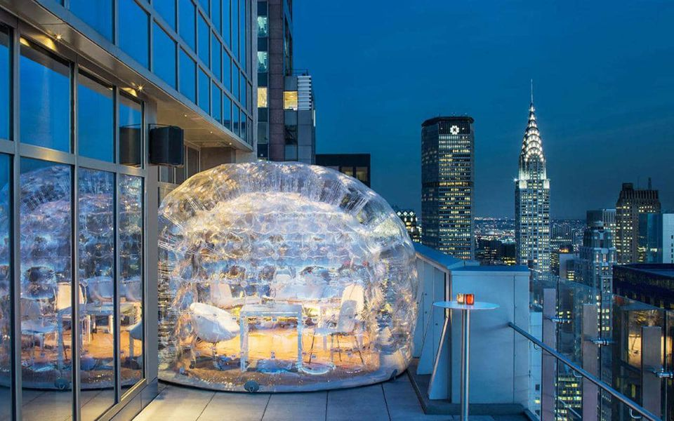 Image result for Bar 54 at the Hyatt Centric Times Square, you can hang out in comfy igloo-like bubbles