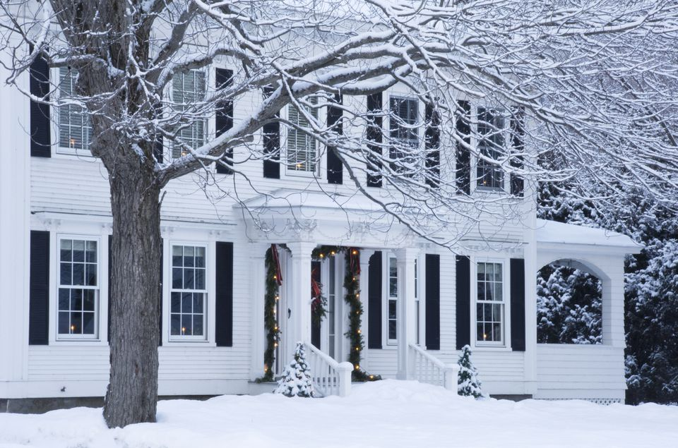 Snow covered house decorated for Christmas in Woodstock, VT