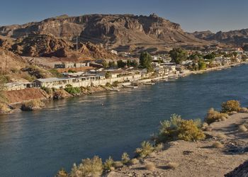 Buckskin Mountains over waterfront houses at Parker and Colorado River below Parker Dam