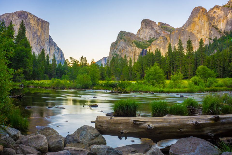 Valley view at Yosemite National Park with El Capitan and Bridalveil Falls behind Merced River, California