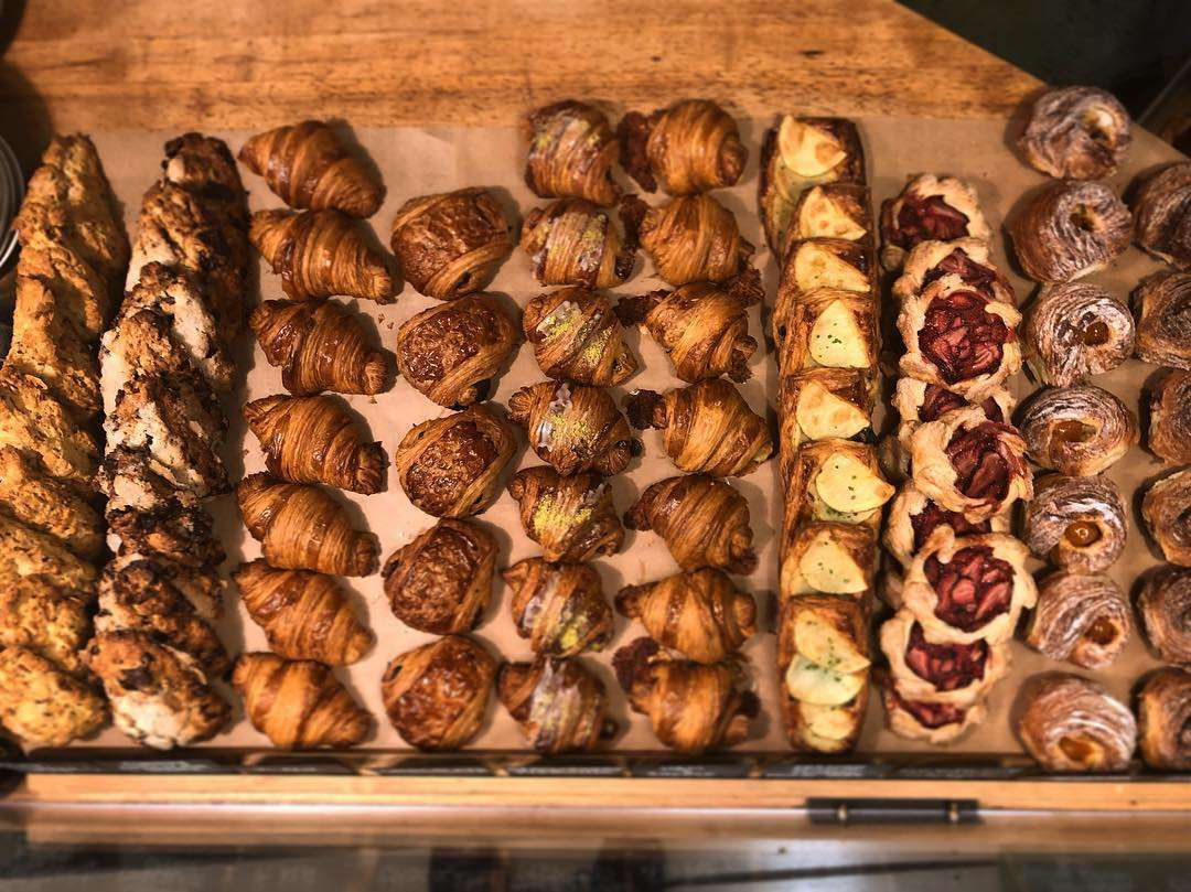 Collection of different pastries in a display case at Wayfarer Bread & Pastry